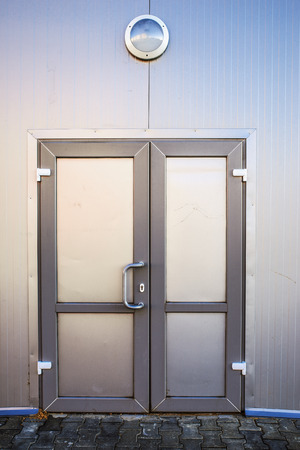 self storage: Metal door in modern industrial building.