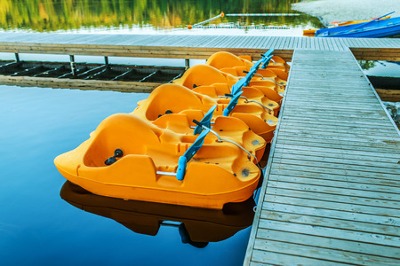 pedal: A pedalo or paddle boat is a small human-powered watercraft propelled by the action of pedals turning a paddle wheel.