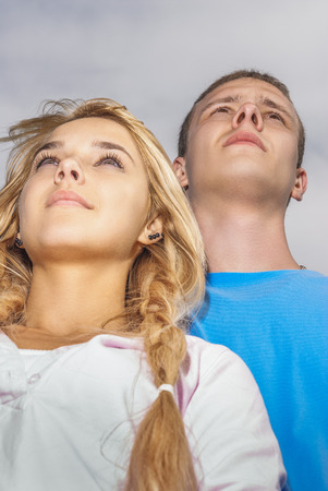 presentiment: Two young enamoured persons look towards to destiny Stock Photo