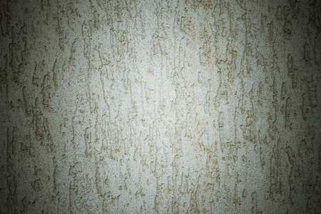 dumps: Wall with cracked plaster and dumps. Texture and background.