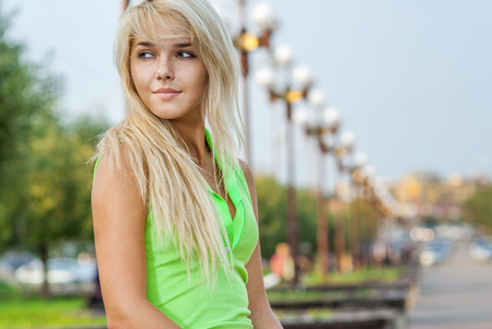sincere girl: Lovely young girl relaxing in a park