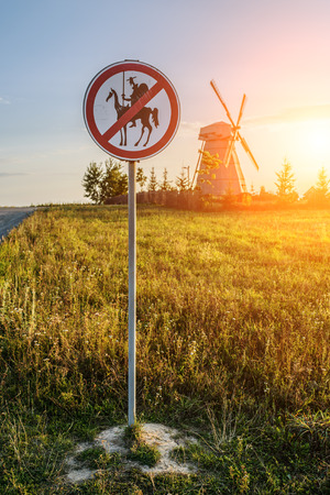 prohibits: Road sign, which prohibits Don Quixote approach to the mill.
