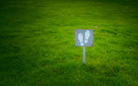 outsole: The sign on the label do not walk on a green lawn. Stock Photo