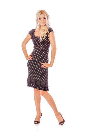 fair complexion: Charming blonde in dark dress, isolated on white .