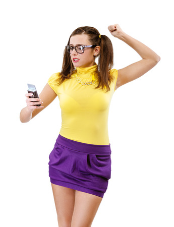 insult: Offended girl-teenager with phone, isolated on white .