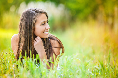 leaned: Beautiful young woman relaxing grass lying leaning hands person leaned