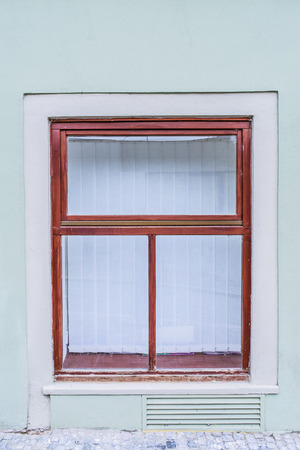 Old window in an ancient European stone house. photo