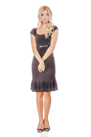 fair complexion: Charming blonde in dark dress, isolated on white background. Stock Photo