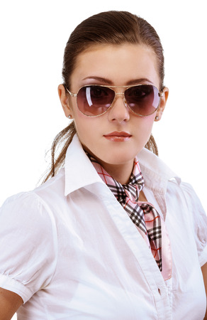 fair complexion: Young woman in sun glasses, isolated on white background.