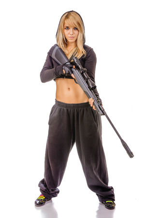 fair complexion: Portrait of women in black clothes and with gun in hands.
