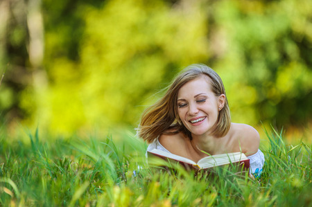 portrait beautiful short-haired young woman reading book photo