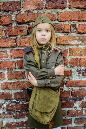 police girl: Little beautiful girl in Soviet military uniforms. Stock Photo