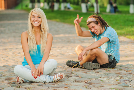 Couple outdoors sit in lotus pose photo