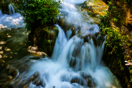 outflow: Before its outflow the Krka is a river in Croatias Dalmatia region forms beautiful and well known waterfalls called Skradinski buk, part of Krka National Park. Stock Photo