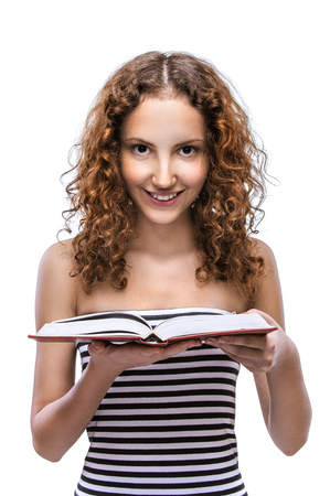 striped vest: Portrait of a beautiful young woman in a striped vest with a red book isolated on white background.