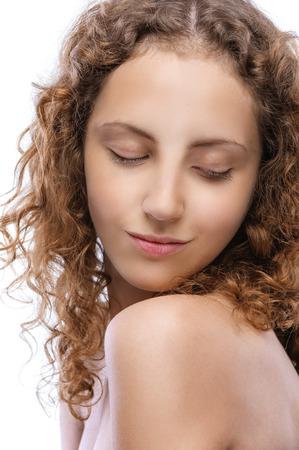 naked young women: Молодая очаровательная женщина закрыла глаза и наслаждается тишиной, на белом фоне.