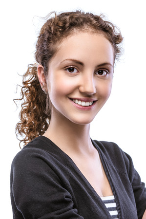 frizz: Portrait of a smiling beautiful young woman in a black jacket and striped vest, isolated on white background.