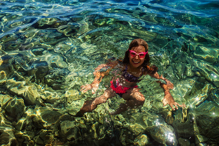 croatia: Little beautiful girl floating in the Adriatic Sea.