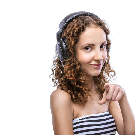 striped vest: Portrait of a beautiful young woman in a striped vest with headphones, isolated on white background. Stock Photo