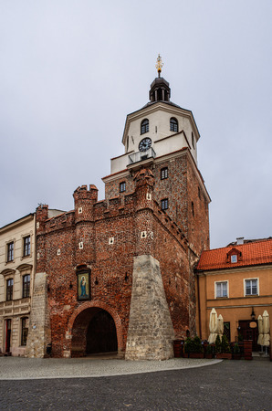 residue: The Cracow Gate - the fourteenth-century gate guarding the access to the Old Town in Lublin, Poland, historic symbol of the castle. The residue ramparts of the fourteenth century. Editorial