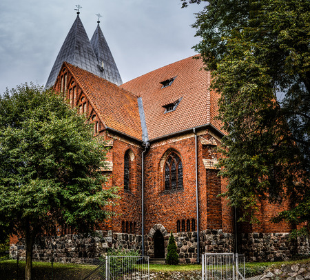 fourteenth: Basilica of St. James the Apostle in Olsztyn - church built in the second half. The fourteenth century. Olsztyn is capital of Warmian-Masurian Voivodeship, Poland. Stock Photo