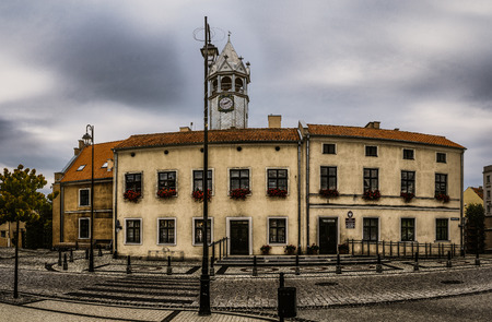 stood: Barczew City Hall - a building located in the center of the city in the middle of the old market, spot where once stood a well city. Barczewo, Olsztyn County, Warmian-Masurian Voivodeship, Poland. Stock Photo