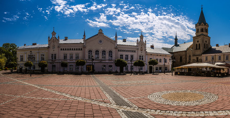 southeastern: Market Square in Sanok. The Royal Free City of Sanok (Wolne Miasto Sanok) is a town in south-eastern Poland with 39,110 inhabitants, as of 2 June 2009. Stock Photo