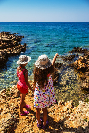 adriatic: Two beautiful little sisters on the rocky shores of the Adriatic Sea in Croatia. Stock Photo
