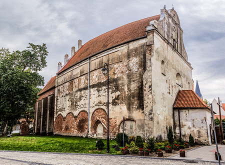 fourteenth: Church of Sts. Andrew the Apostle in Barczewo - Gothic church built in late fourteenth century. At monastery of Conventual Franciscans. Barczewo, Olsztyn County, Warmian-Masurian Voivodeship, Poland. Stock Photo