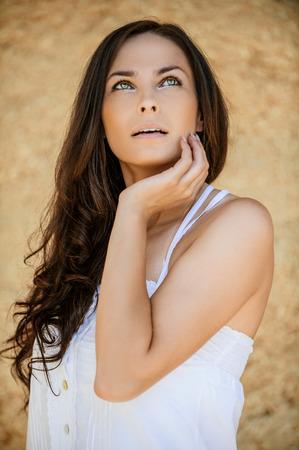 romantic beautiful long dark hair woman looking up photo