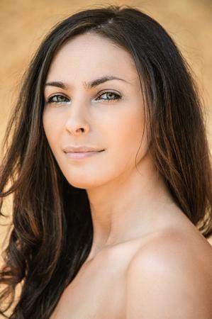 beautiful woman long dark hair bare shoulders photo