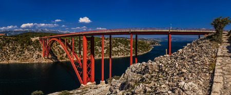 approximately: The Maslenica Bridge is a deck arch bridge carrying the D8 state road approximately 1 km to the west of the settlement of Maslenica, Croatia