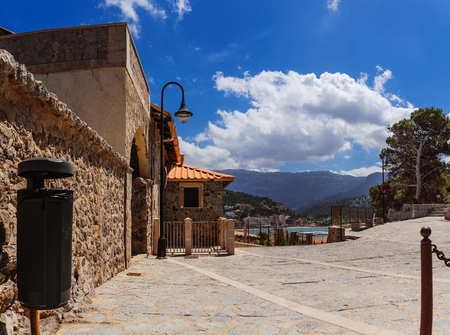 sea of houses: Old chapel, Oratorio de Santa Caterina de Alexandria on a hill in entrance to Port of Soller, now houses museum of sea. This is Museu de la Mar, Mallorca of Balearic Islands in Spain. Stock Photo