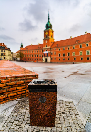 Memorable sign UNESCO near Panorama of Royal Castle in Warsaw, Poland is castle residency and was official residence of Polish monarchs. It is located in Castle Square, at entrance to Warsaw Old Town Editorial