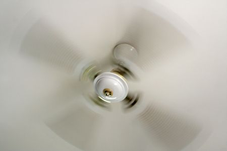 ceiling fan: White ceiling fan captured spinning   Stock Photo
