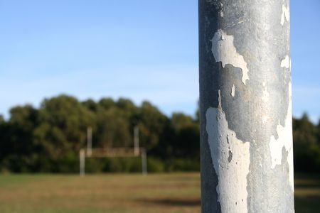 football goal post: Football goal post in the foreground with the other set of posts shown in the distance at the other end of the ground