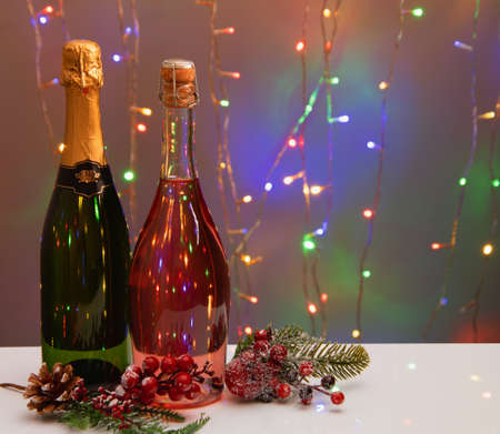 New Year Toast champagne , Christmas lights background with festive decorations Stock Photo
