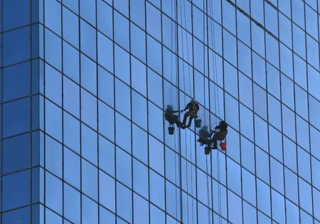 Window washers in downtown st. louis.