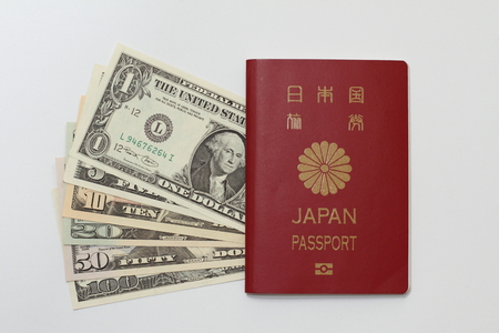 us dollar: Japanese passport and US dollar Stock Photo