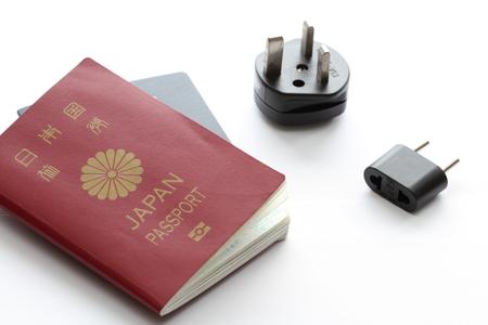 electric plug: Japanese passport and electric plug Stock Photo