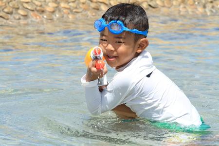 water gun: Japanese boy playing with water gun