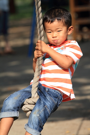 tarzan: Japanese boy playing with Tarzan rope