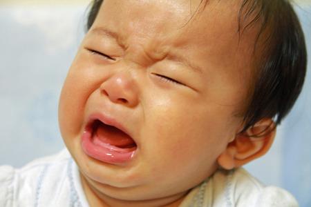 泣いている赤ちゃん (日本男児) 写真素材