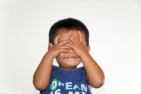 peekaboo: Japanese boy playing peek-a-boo