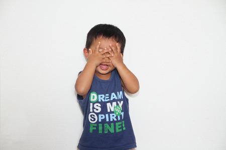 peek a boo: Japanese boy playing peek-a-boo