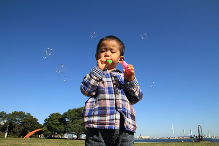 Japanese boy playing with bubble