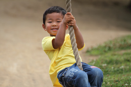 tarzan: Japanese boy playing with Tarzan rope (3 years old) Stock Photo