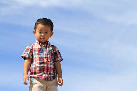 Japanese boy under the blue sky Stock Photo