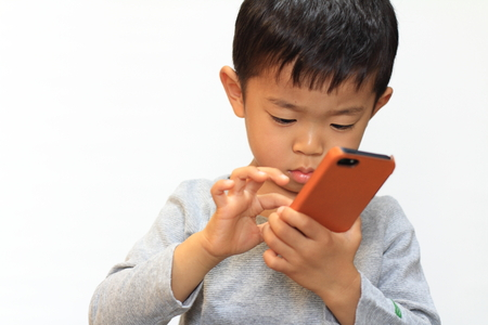 Japanese boy using smart phone