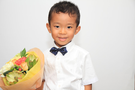 Japanese boy and a bouquet photo